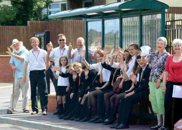 PROBLEM SOLVED: Villagers at Shipton Gorge celebrating their new bus stop