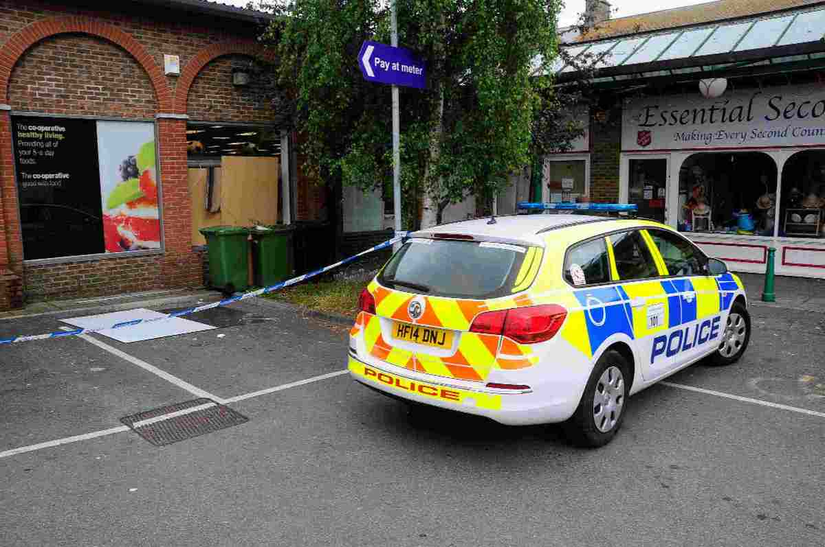 BREAK-IN: Police car next to the Co-op window which was removed by the burglars