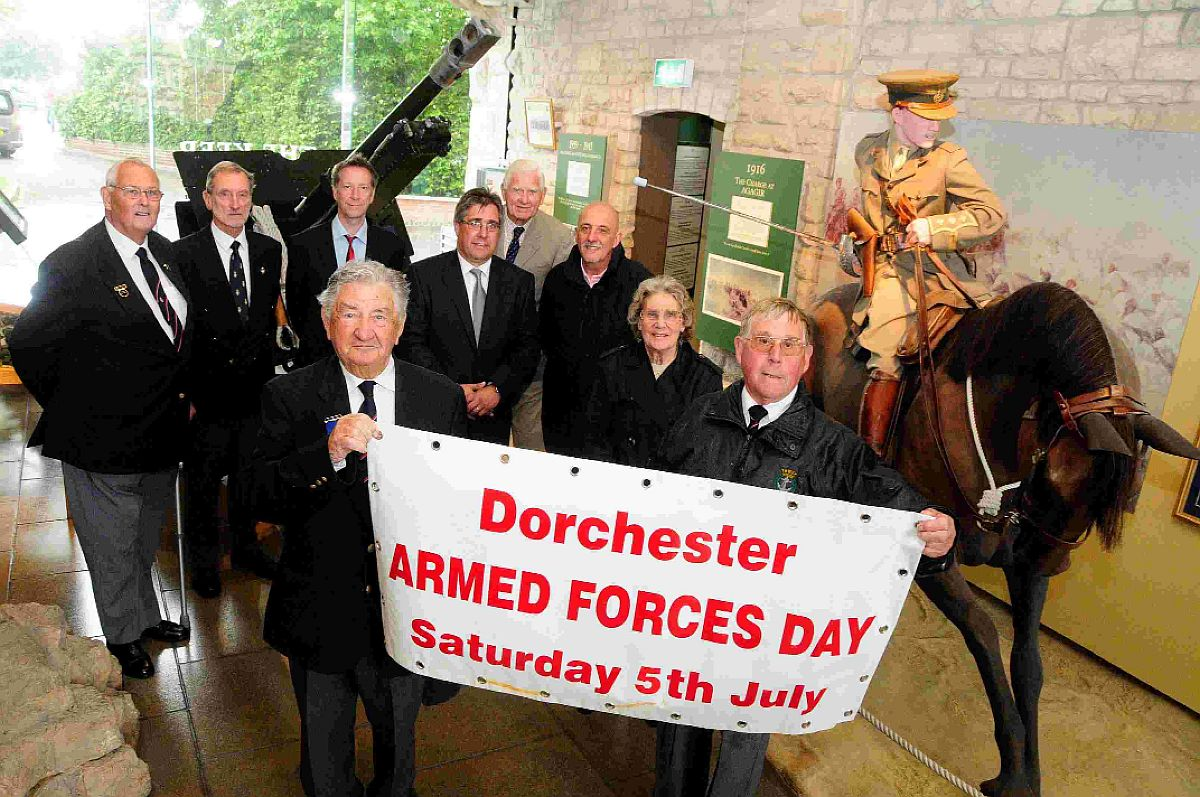 UNITED FRONT: George Osborne and Dennis Matthews with other members of the Armed Forces Day organising committee at The Keep Military Museum