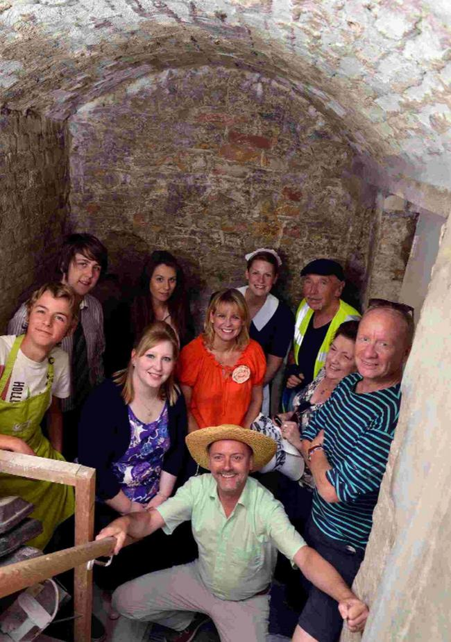 GOING  UNDERGROUND: David Taylor and some of representatives from the shops  in th tunnel under Antelope Walk