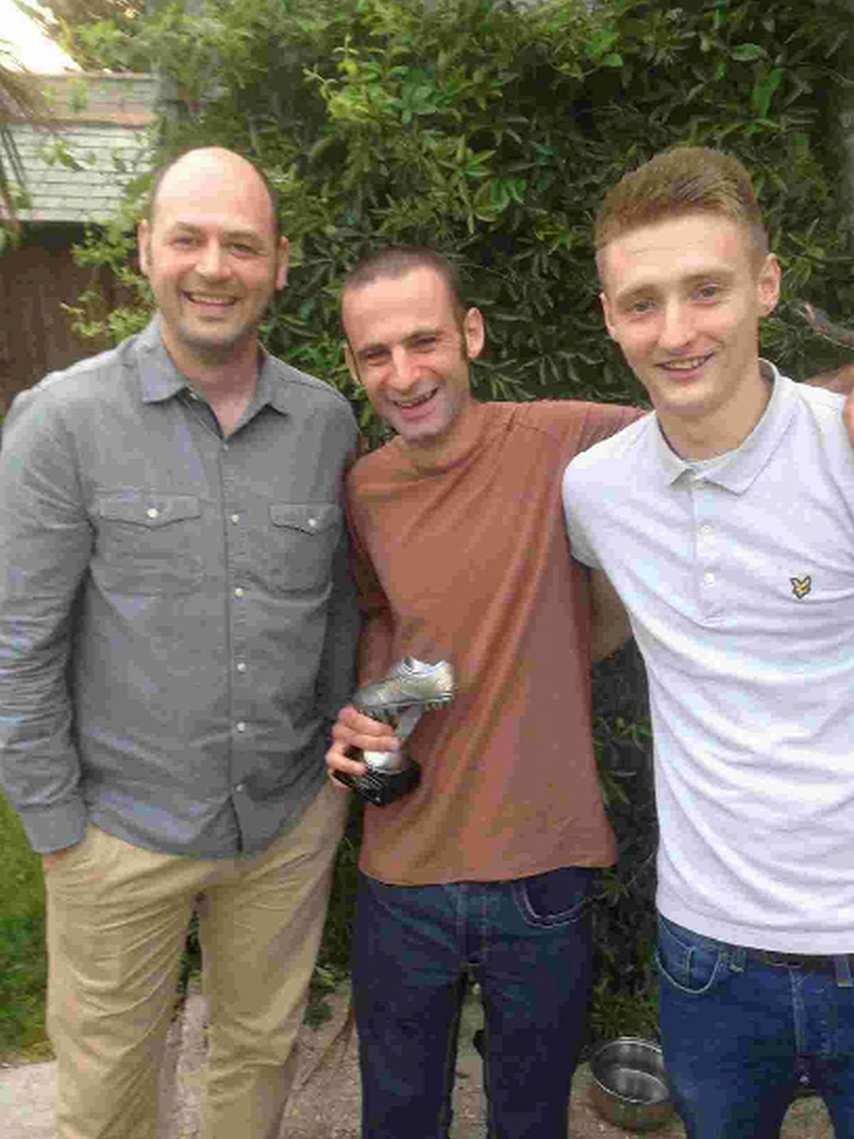AWARDED: A team members Adam Sedwell, centre, and Luke Moorley, right, with manager Pete Williams
