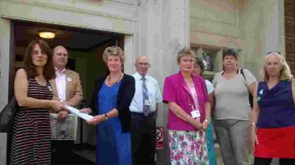 Eleanor Parker presents a petition to Cllr Jill Haynes, with members of Unison and councillors in support of Phoenix House