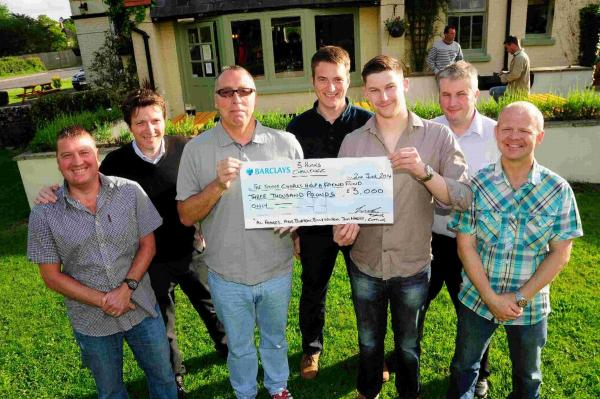 TEAM EFFORT: The Three Peaks challengers present their cheque to the Steve Charles Help a Friend Fund at the Blue Vinney pub