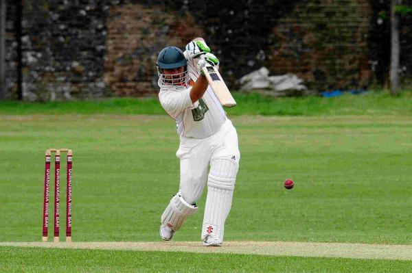 DOWN THE GROUND: Dorchester all-rounder Pete Moxom