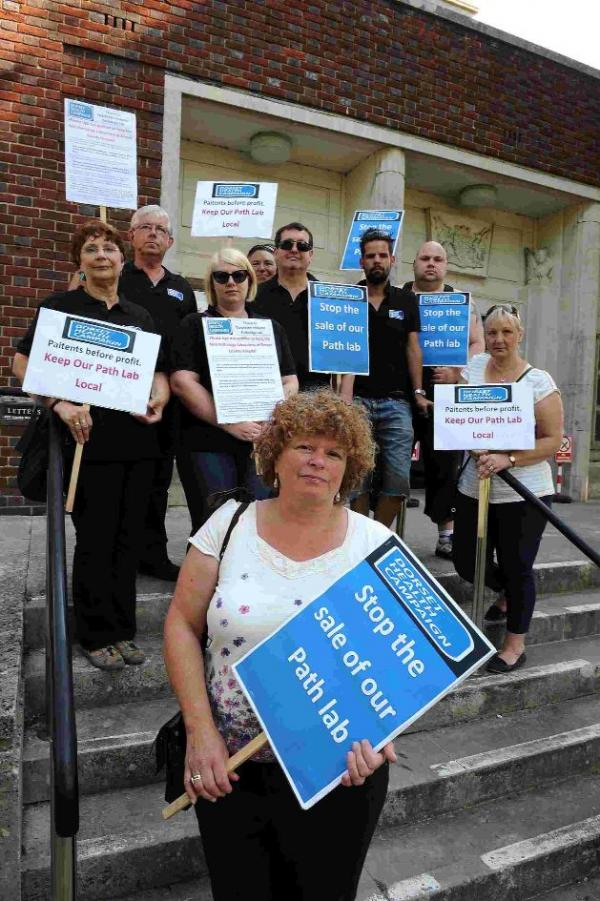 CAMPAIGNING: Members of the Dorset Health Campaign lobbying the Dorset Health Scrutiny Committee about plans to transfer path lab services from DCH