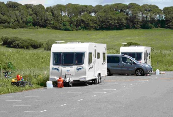 CAMP: Travellers at the Weymouth park and ride site in June - now a new site at Piddlehinton has opened for visiting groups