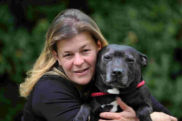 REUNITED: Sharon Collings with her Staffordshire bull terrier Ellie