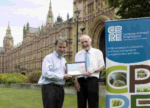 HONOURED: West Dorset MP Oliver Letwin with Bob Kerr from Dorchester Stop the Drop and his award from the CPRE outside the Houses of Parliament