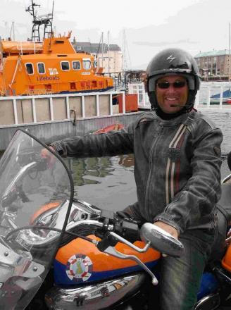ON THE ROAD: Motorcyclist Matt Hawkes visits Weymouth Lifeboat Station on his venture aroun