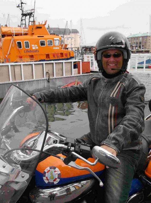 Dorset Echo: ON THE ROAD: Motorcyclist Matt Hawkes visits Weymouth Lifeboat Station on his venture around Great Britain to raise money for the RNLI
