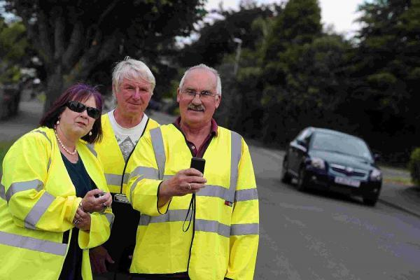 Dorset Echo: CAMPAIGN SUCCESS: Speedwatch volunteers  Barry Preedy, right, with Chrissy Brooks and Robin Potter