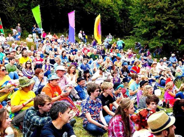 GATHER ROUND: Crowds watch live music