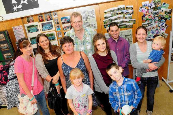 Dorset Echo: RETURN: Headteacher Peter Farrington with ex-staff, past and present pupils in front of the memory wall