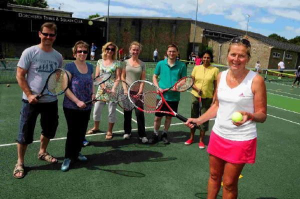 ON COURT: Sarah Skidmore gives coaching tips to members of the public