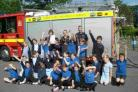Children from Sticklands Primary School receive their SAFE-D gold award from fire officers from Maiden Newton