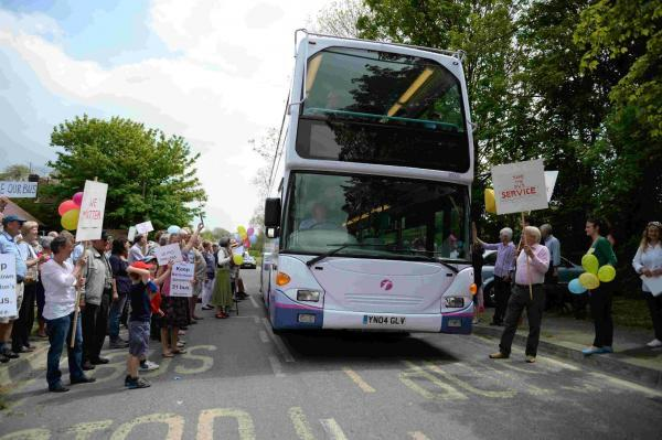 OPTIMISTIC: The bus protesters at Martinstown who want to see the 31 service restored