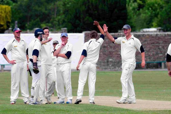 BREAKTHROUGH: Beaminster's Jack Walklett celebrates after taking a wicket