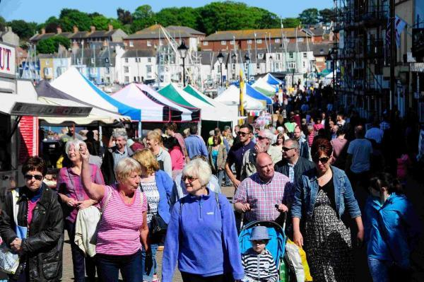 COMMUNITY SPIRIT: Crowds fill the street along the harbourside at the Fayre in the Square