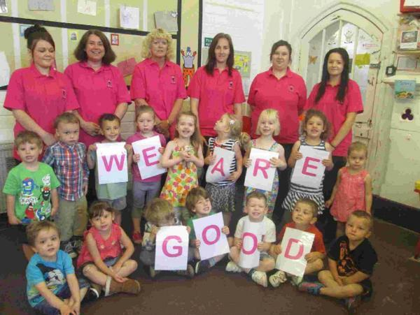 Staff at Wonderland Day Nursery in Bridport celebrating after their good Ofsted report in June 2014