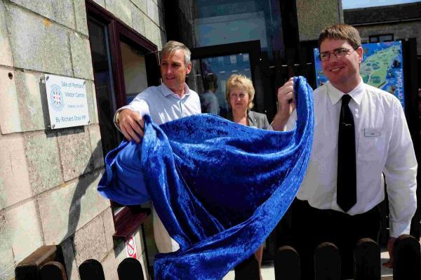 OPEN: South Dorset MP Richard Drax unveils a plaque at the new visitors centre at Heights Hotel, with the help of Angie Mustill and Mike Deadman. Picture: GRAHAM HUNT