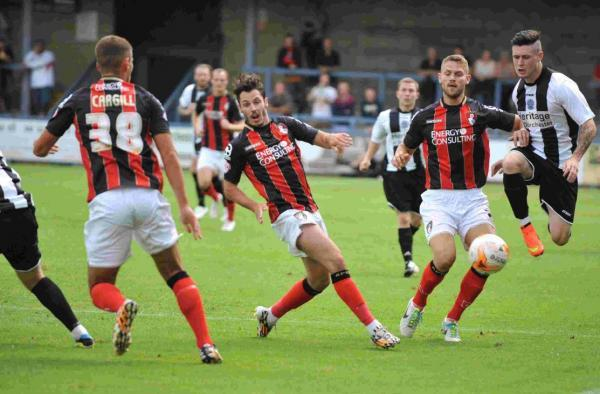 OUTNUMBERED: Dan Smith, right, tries to stop the Cherries' onslaught