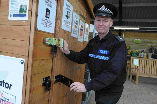 THEFTS DECREASE: Inspector Steve Marsh with the sheducation shed at Poundbury Garden Centre