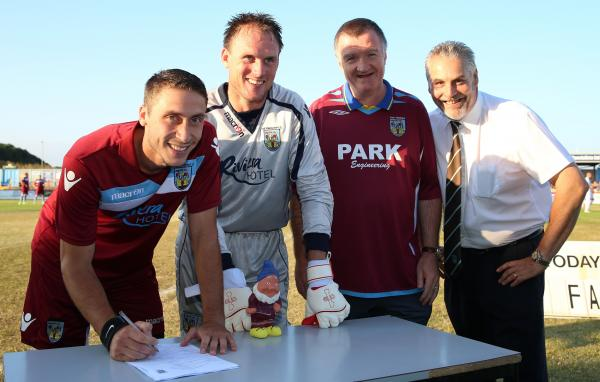BACK IN TOWN: Chris McPhee signs for the Terras