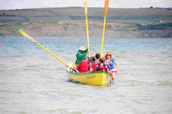 PADDLES UP: Water craft with the Weymouth Gig Rowing Club