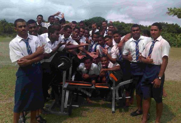 HELPING HAND: The Fijian students show off their new equipment