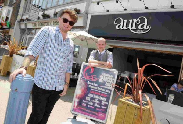 Tom Ryan, left, fundraising for CLIC Sargent charity, at Aura with manager Chris Dredge