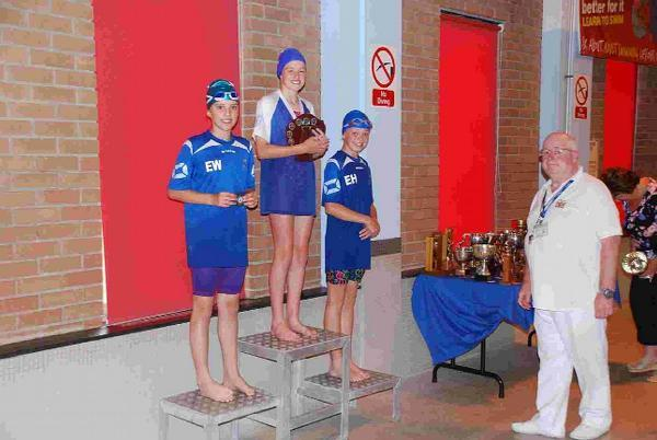 ON THE PODIUM: The girls' 11-12 50m butterfly champion Alice Adams with Ellie Wilcox and Ellie Hope