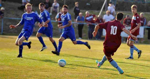 STRONG DEFENCE: Portland on the back foot against Weymouth