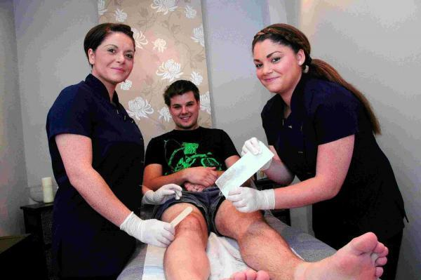 Adam Crabb having his legs waxed at Akemi Spa in Dorchester for his cycle ride in aid of Prostate Cancer UK