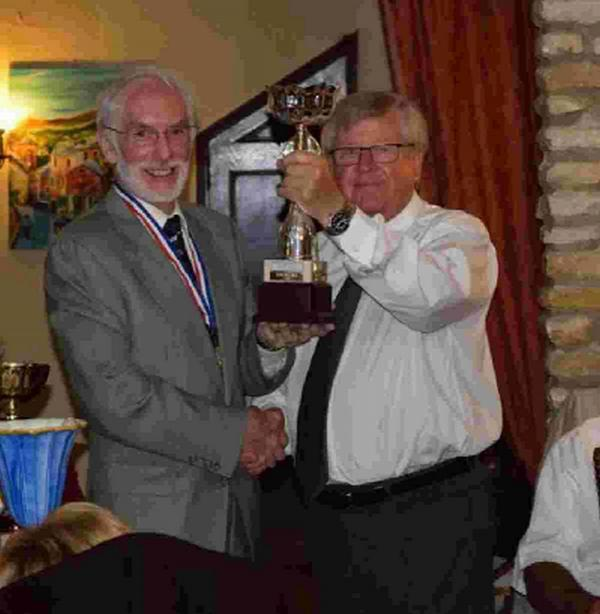 HOT-SHOTS: Dorchester chairman Richard Burden, left, receives the rifle trophy from Jacques Lechevallier