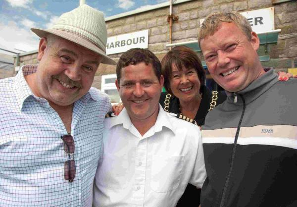 Minty and Garry from Eastenders with West Bay Harbourmaster James Radcliffe and Cllr Gillian Summers.