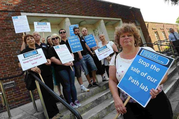 CAMPAIGNERS: Members of the Dorset Health Campaign lobbying the Dorset health scrutiny committee about plans to transfer path lab services