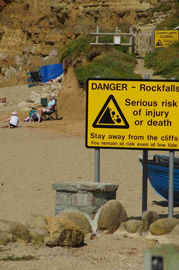 Beachgoers risk lives underneath unstable cliff faces