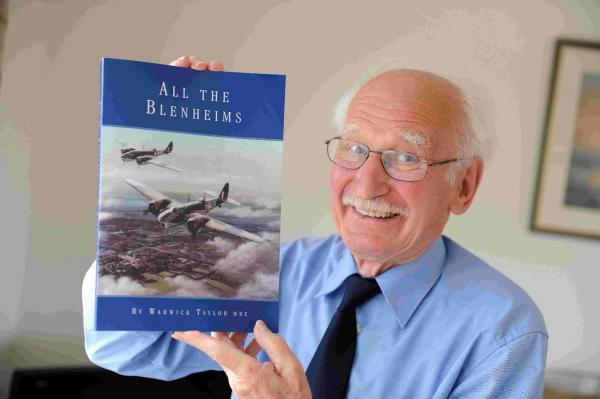 Warwick Taylor with his book All The Blenheims