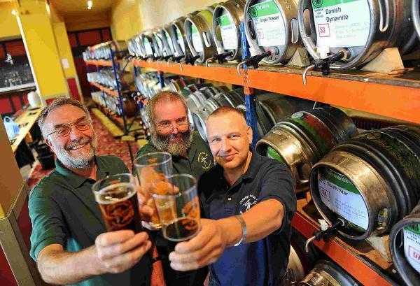DRINKING HATS: Weymouth Beer Festival, left to right, Dave Harris, organiser and chairman of West Dorset CAMRA, Russell Ware and Rich Gabe, CAMRA bar manager