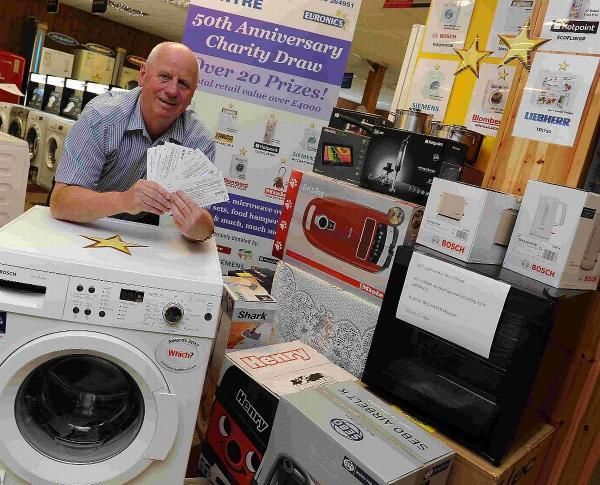 GET LUCKY: Ian Barrett with £4k of prizes he is raffling off to raise funds for Weldmar as DAC celebrates 50th birthday