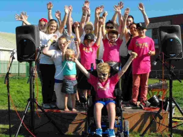 FUNDRAISING: Children and volunteers from Dreamflights' Peter Pan group at last year's 2013 Fun Day in Weymouth