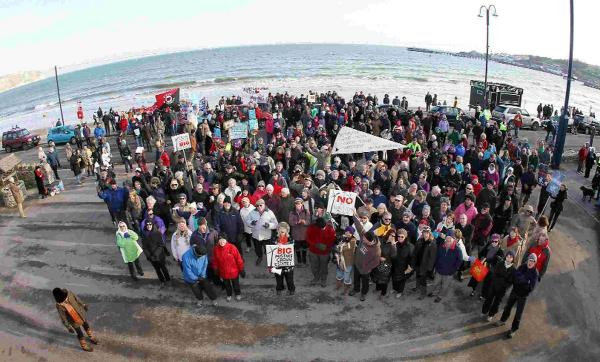 People gather on Swanage seafront to protest both against and in favour of the Navitus Bay wind farm