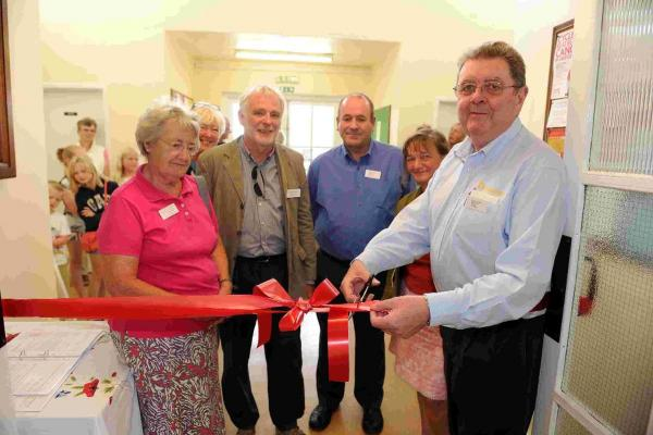 Chairman of trustees Graham Brant cuts the ribbon at Upwey and Broadwey War Memorial Hall