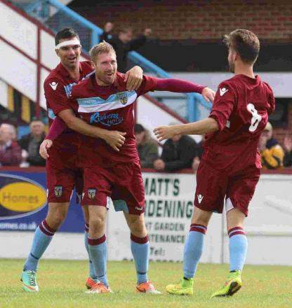 JAMIE'S JOY: Jamie Laird celebrates scoring with Tim Sills, left, and George Rigg