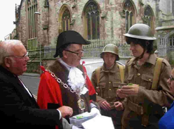 Dorchester's Mayor Peter Mann meets young volunteers for the town's 'Walking in their Shoes' project commemorating WW1.