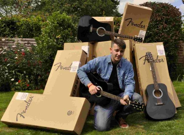 RECORD: Ben Kapur, the 21-year-old Lyme musician, welcomes a donation by Fender to Guitars on the Beach