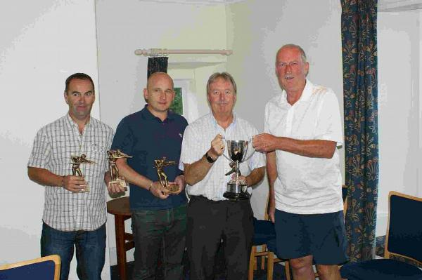 CHAMPIONS: League chairman Richard Bryant, right, presents the Snooker League Trophy to West Dorset Club A. From left: Graham Bartlett, Evan Wellman and Mike