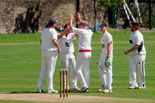 HOWZAT: Simon Mitchem takes a wicket at the Rec