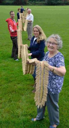 Woman completes what could be world's longest corn dolly