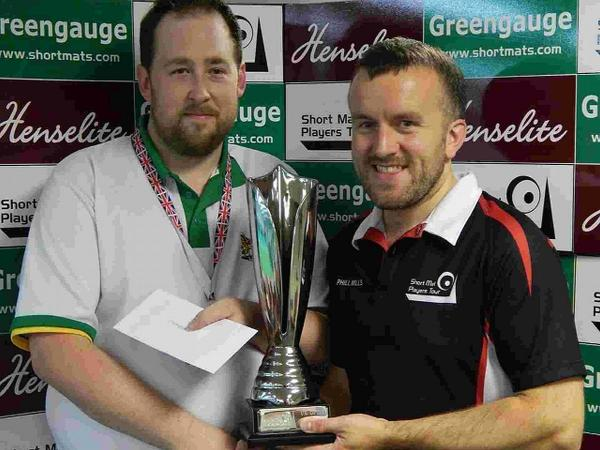 CHAMPION: Wool's Robert Martin, left, receives the UK Open trophy